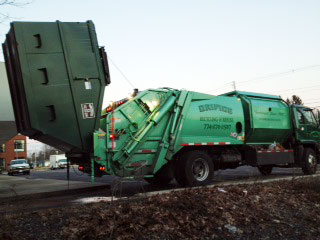commercial truck picks up waste